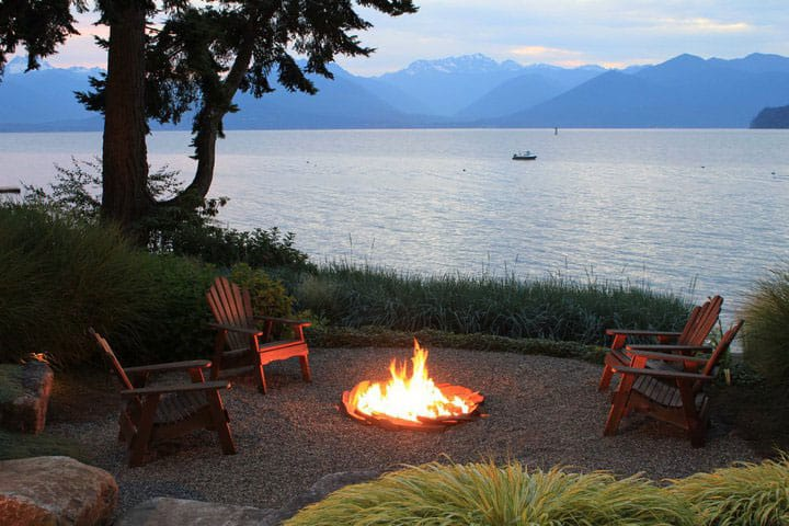 A Dan Blossom beachscape with a fire pit